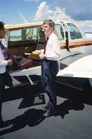 Jeff Bingaman boards a private airplane
